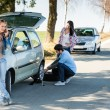 Wheel defect man helping two female friends — Stock Photo #10235103