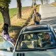 Hitch-hiking parked car girl friends offer lift — Stock Photo #10235154