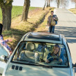 Hitch-hiking parked car girl friends offer lift — Stock Photo #10235171