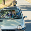 Exciting girls drive car taking hitch-hiker — Stock Photo #10235186