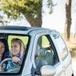 Exciting girls drive car taking hitch-hiker — Stock Photo