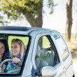 Exciting girls drive car taking hitch-hiker — Stock Photo #10235200