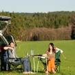 Camping car young couple enjoy picnic countryside - Foto Stock