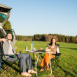 Camping car young couple relax picnic countryside — Stock Photo