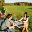 Camping car young couple enjoy picnic countryside - Stock Photo