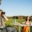 Camping car young man look telescope countryside - Stock Photo