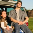 Camping couple inside car enjoy summer sunset — Stock Photo