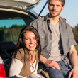 Camping young couple smiling together - Stock Photo