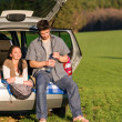 Camping couple inside car summer sunset countryside — Stock Photo #10235378