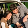 Camping car happy couple look camera sunset - Stock Photo
