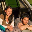 Royalty-Free Stock Photo: Camping young couple lying car summer sunset