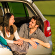 Camping young couple lying car summer sunset — Stock Photo #10235407