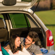 Camping young couple lying car summer sunset — Stock Photo #10235417