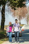 Out of gas couple need petrol car — Stock Photo