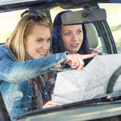 Road trip car lost women search map — Stock Photo