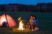 Camping night couple cook by campfire romantic — Stok fotoğraf