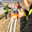 geodesist measure land with tacheometer highway — Stock Photo