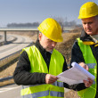 geodesist read plans on construction site — Stock Photo