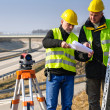 Geodesist read plans on construction site — Stock Photo #10515190