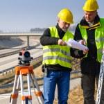 Geodesist read plans on construction site — Stock Photo #10515190