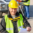 Stock Photo: Land geodesist man hold plan reflective vest