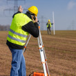 Foto Stock: Geodesist measure land speak transmitter