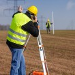 Stockfoto: Geodesist measure land speak transmitter
