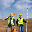 Geodesist two man equipment on construction site - Stock Photo