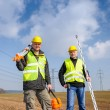 Stock Photo: Geodesist two man equipment on construction site