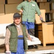 Mover two man loading furniture and boxes — Stock Photo