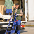 Mover two man loading furniture on truck — Stock Photo #10515249
