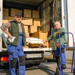 Постер, плакат: Two mover load van with furniture boxes