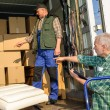 Two mover load vwith furniture boxes — Stock Photo #10515274