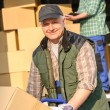 Stock Photo: Delivery service mover man cardboard box