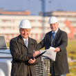 Stock Photo: Architect man make notes on construction site