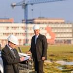 Architect man make notes on construction site — Stock Photo