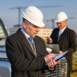 Architect man make notes on construction site — Stockfoto