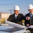 Architect developer point at construction site — Foto Stock