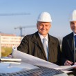 Architect developer hold construction plan — Stock Photo
