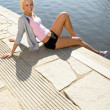 Sport woman summer relax water pier — Stock Photo