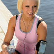 Sport woman smiling relax water sitting pier — Stock Photo