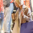 Stock Photo: Woman shopping bags enjoy evening city