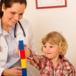 Visit at pediatrician child girl playing — Stock Photo