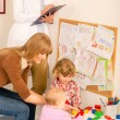 Stock Photo: Pediatricifemale review children play activity