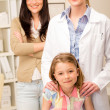 Little girl at pediatrician office with mother — Stock Photo
