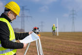 Geodesist measure land on construction site — Stock Photo