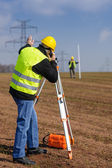 Geodesist measure land speak transmitter — Stock Photo