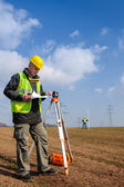 Geodesist measure land look construction plan — Stock Photo