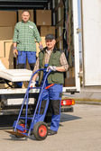 Mover two man loading furniture on truck — Stock Photo
