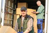 Delivery service mover man cardboard box — Stock Photo